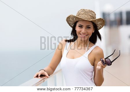 portrait of pretty woman holding sunglasses on a cruise