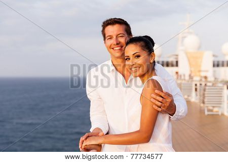 portrait of beautiful young couple at sunset on a cruise ship