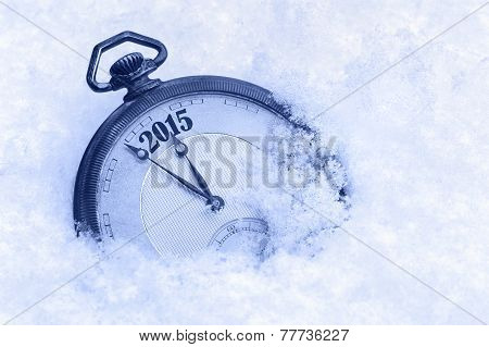 Pocket watch in snow New Year 2015 greeting card