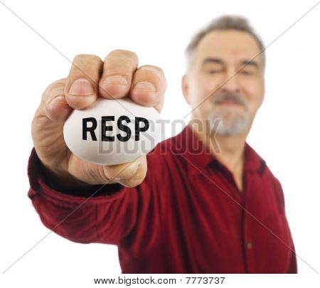 Mature Man Holds White Nest Egg With RESP On It.