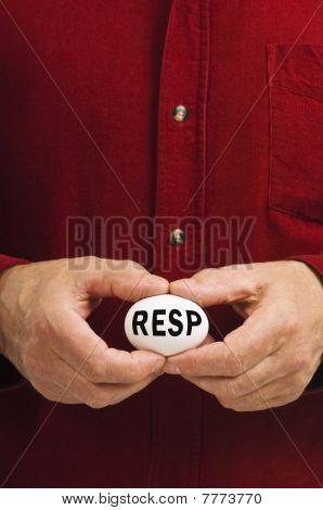 RESP Written On White Nest Egg Held By Man
