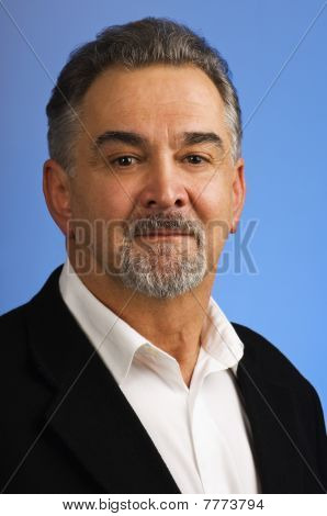 Serious Mature Man Against Blue Background