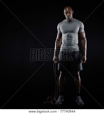 Fit And Muscular Man With Jumping Rope