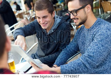Outdoor Portrait Of Young Entrepreneurs Working At Coffee Bar.