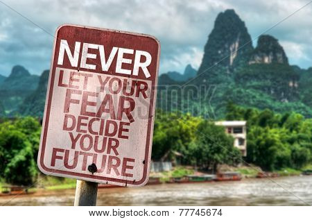 Never Let Your Fear Decide your Future sign with a forest background