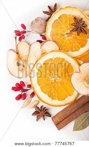 Christmas spices and dried orange sliceson