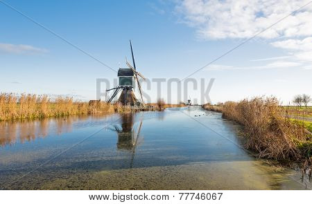 Dutch Windmills In The Autumn Season