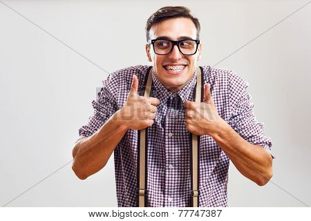 Nerdy man giving thumbs up