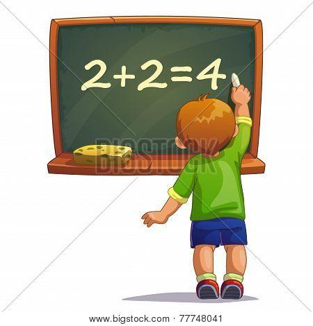 boy writes with chalk on a blackboard
