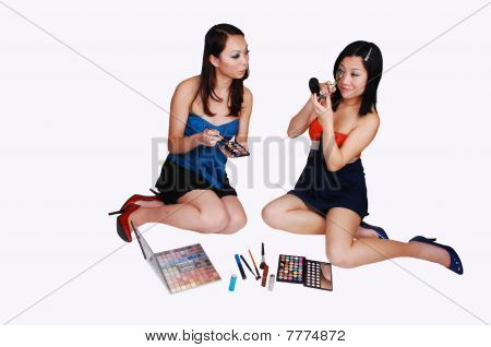 Two Chinese Girls Doing Makeup.