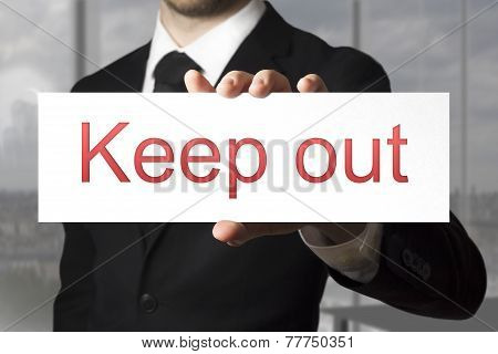 Businessman Holding Sign Keep Out