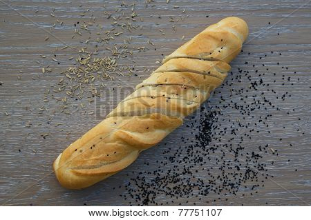 French baguette on a wooden surface
