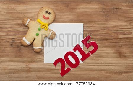 Christmas 2015 cookie with homemade christmas painted ginger breads (gingerbread man) on the wooden background