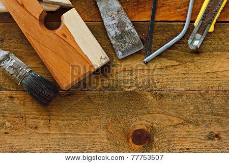 Various Old Diy Tools On Rustic Wooden Work Bench
