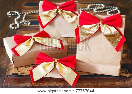 Christmas Gifts Paper Package With Red Golden Bow And Chaplet