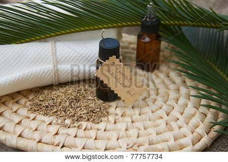 Cardamom essential oil on a woven surface