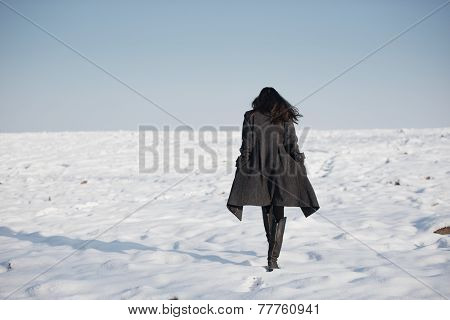 beautiful girl alone in winter field