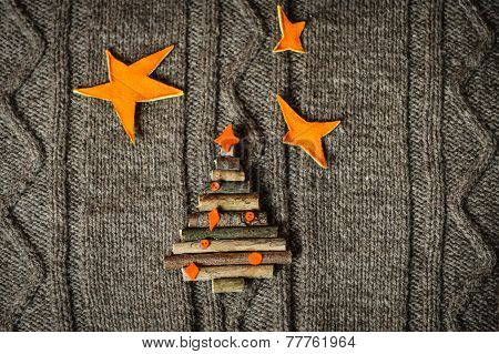 Handmade Christmas decoration on warm knitted background. New year concept.