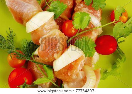 served fresh chicken kebabs on dark plate