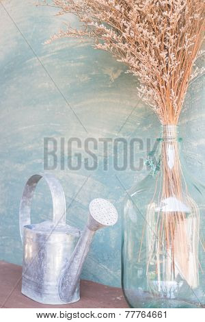 Glass Vase Of Dried Flower And Watering