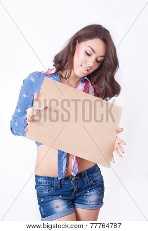 Cute Surprised Girl  With A Sign In Hands
