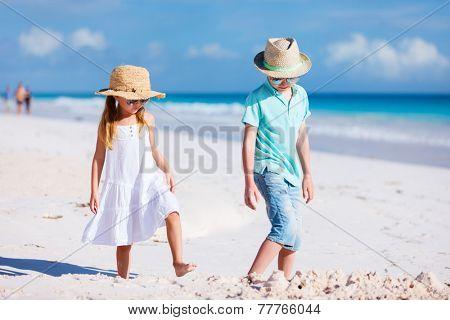 Brother and sister at beach enjoying vacation