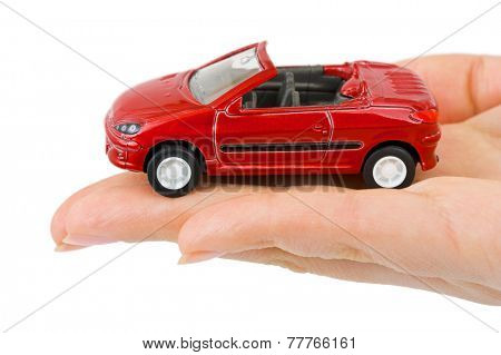 Toy car in hand isolated on white background