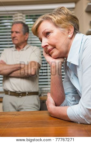 Senior couple having an argument at home in the kitchen