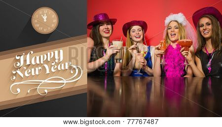 Laughing friends having hen party holding cocktails against classy new year greeting