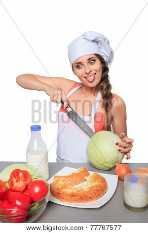 female chef holding a knife with expression