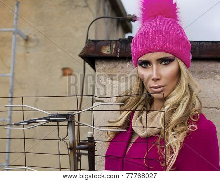 Strong Woman In Pink Coat On Roof
