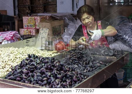 Vendor Preparing Water Chestnuts