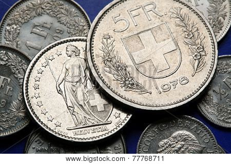 Coins of Switzerland. Coat of arms of Switzerland depicted in the Swiss five franc coin.