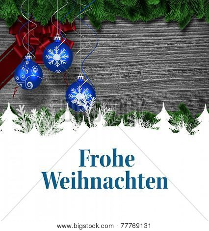 Christmas greeting in german against christmas baubles hanging over wood