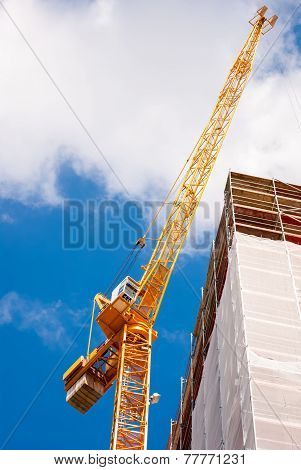 Construction Crane Besides A Building