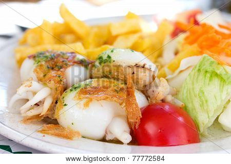 Fried cuttle fish with salad