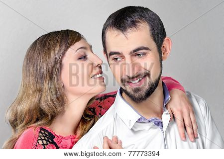 Woman Whisper To Boyfriend Putting A Hand On His Shoulder