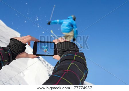 Photographed Skiers Jump With Cell Phone
