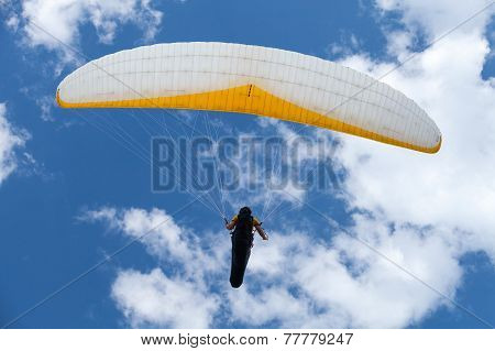 Paraglider In The Blue Sky With Clouds