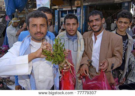 Men buy khat (Catha edulis) at the local market in Lahij Yemen.