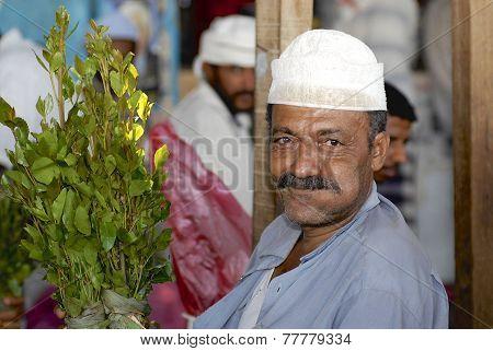 Man sells khat (Catha edulis) at the local market in Lahij, Yemen.