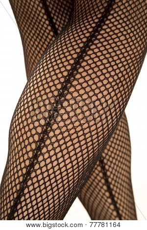 Back Of Womans Legs In Fishnet Crossed
