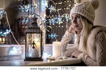 Woman in white hat, Christmas eve and New Year