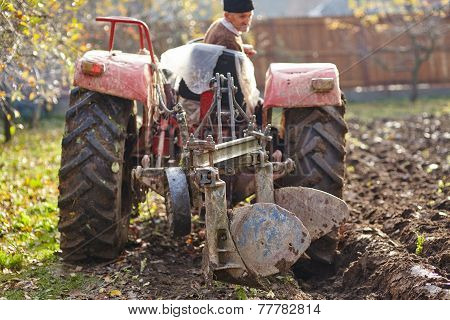 Senior Farmer Plowing