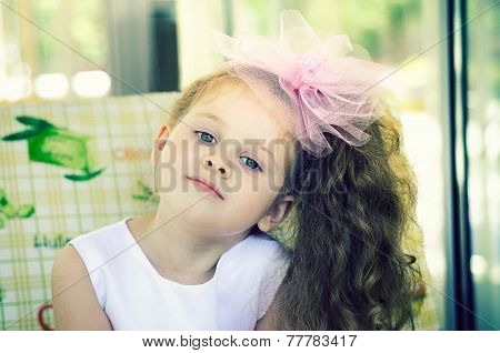 Little girl with a bow