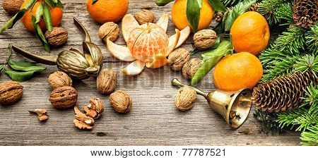 Mandarine Fruits, Walnuts And Christmas Tree Branches