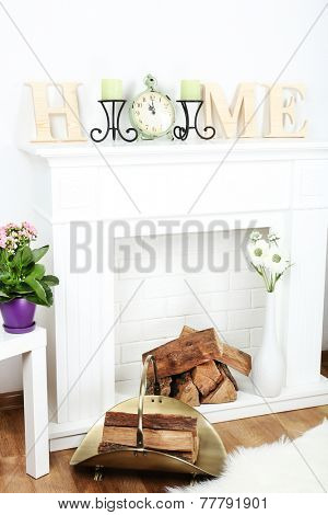 Fireplace with beautiful decorations in living room