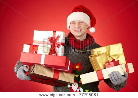 Santa man with two piles of giftboxes