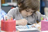 stock photo of lonely  - One cute lonely girl drawing at kindergarten - JPG