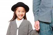 stock photo of kindergarten  - Japanese kindergartener walking to kindergarten with her father - JPG